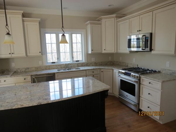 Photo of owner inspired custom design new home - kitchen