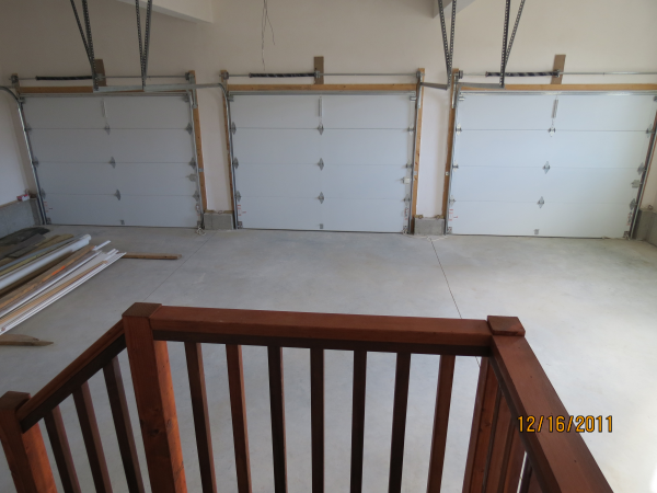 Photo of owner inspired custom design new home - 3 car garage view