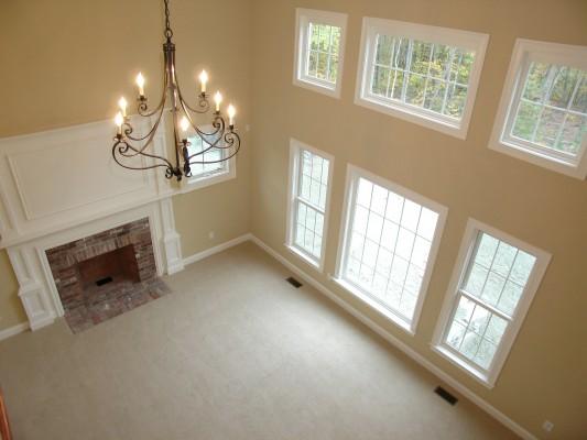 Photo of owner inspired custom design new home - Family Room Photo