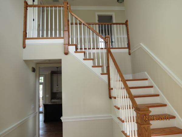 Photo of owner inspired custom design new home - stair case view