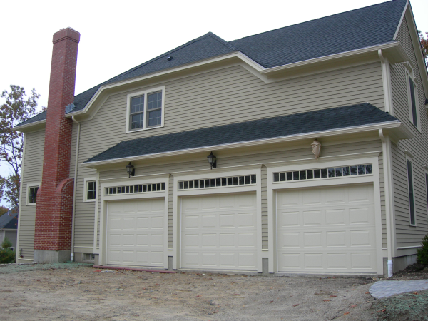 Photo of owner inspired custom design new home - exterior garage view