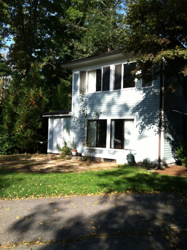 Photo of 3-season porch addition - home rear view