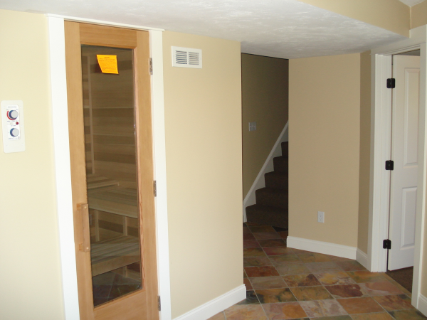 Photo of home lower level conversion to Rec Rm - view of sauna entrance