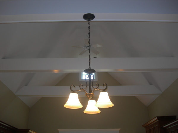 Photo of box beam kitchen ceiling in new home