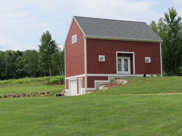Photo of red New England barn near new home
